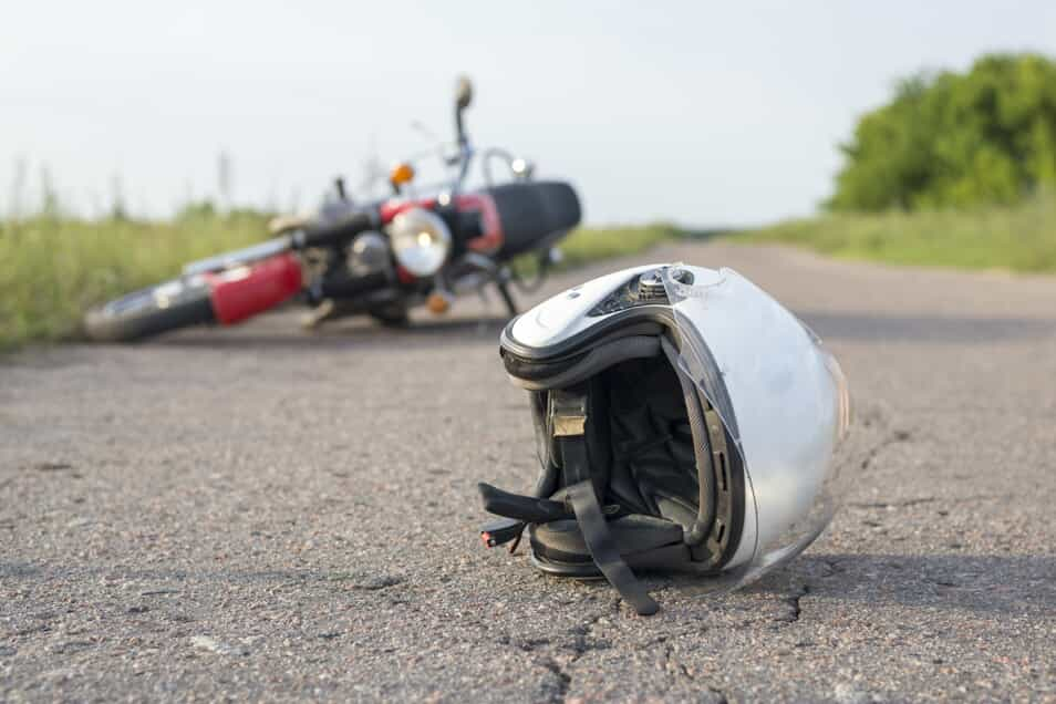 Motorcycle and Helmet on the Ground